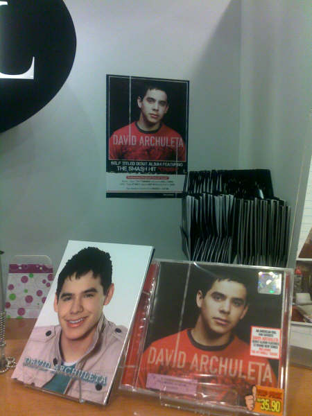EVERYTHING DAVID DISPLAYS IN THE BOUTIQUE. THE POSTER OF DAVID ON THE WALL WAS A PROMOTIONAL POSTER FOR CD OUTLETS.