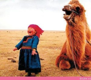 super-happy-baby-with-a-super-happy-camel
